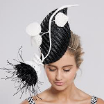 Model Sarah Czarnuch wearing Rebecca Share fascinator with flower made using her pods